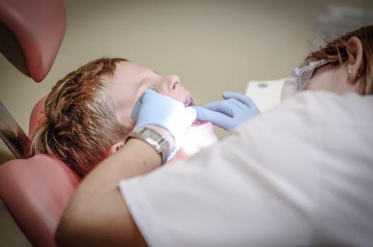 Orthodontist in Glasgow inspecting someones teeth