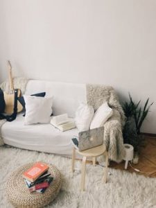 Sofa taking up most space in small room