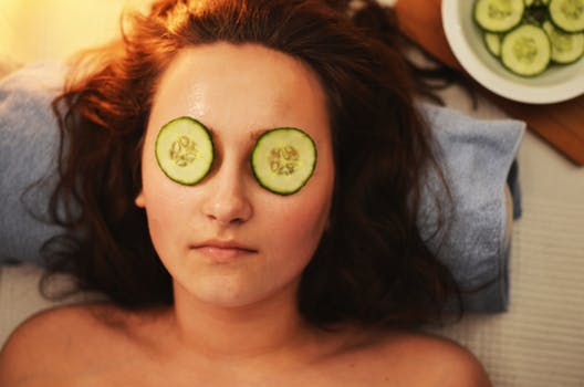 Cucumber on a woman's eyes is an old beauty trend